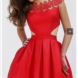 Red cut out Sherri Hill prom dress